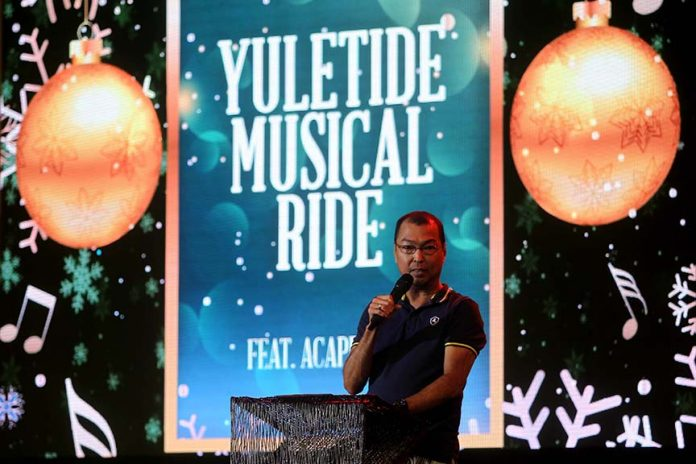 ASSISTANCE. Abreeza Mall general manager Luigi Escano talks about the management's support to the Help Educate and Rear Orphans (HERO) Foundation, Inc., a non-profit organization that aims to help children of soldiers killed in action, during the mall's Christmas launch dubbed Yuletide Musical Ride on Sunday. LEAN DAVAL JR.