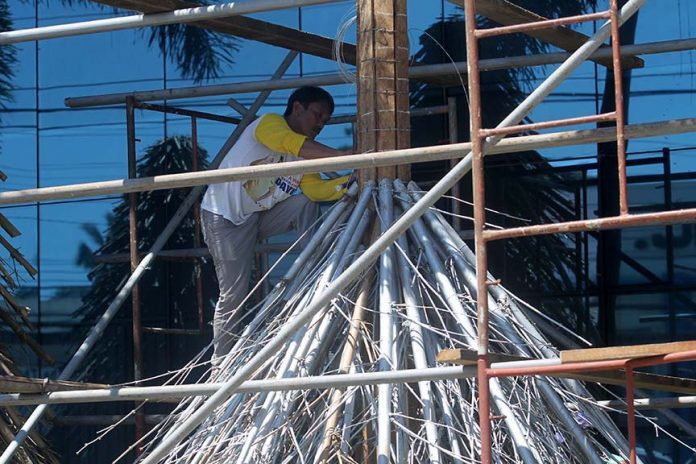 INDIGENOUS. A worker assembles Anflocor's Christmas tree which is made up of bamboo in front of the company's office in Lanang, Davao City on Thursday. LEAN DAVAL JR.