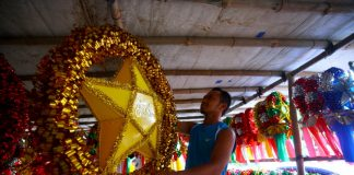 OPEN FOR BUSINESS. John Cañete displays a huge traditional Filipino Christmas lantern which he sells for P750 each inside a makeshift store along Tionko Avenue in Davao City on Monday. Sales of lanterns and other decors are starting to pick up as Christmas Day is fast approaching. LEAN DAVAL JR.