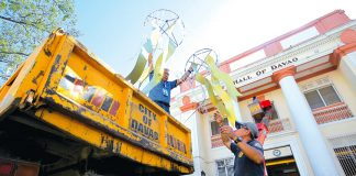 GEARING UP. Employees of the city government of Davao unload Christmas decorations in front of City Hall which is once again being transformed into a Christmas attraction on Monday. The city is gearing up for the grand opening of this year's Pasko Fiesta set on December 5. LEAN DAVAL JR.
