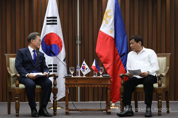 HEALTHY EXCHANGE. President Rodrigo Duterte and Republic of Korea President Moon Jae-in exchange pleasantries prior to the start of the bilateral meeting at the Philippine International Convention Center in Pasay City on Monday evening. PRESIDENTIAL PHOTO