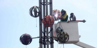 INNOVATION. Workers install the ethnic inspired Yuletide balls to the city government of Davao's huge Christmas tree at Rizal Park on Saturday. LEAN DAVAL JR.