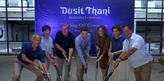 MILESTONE. Torre Lorenzo Development Corporation (TLDC) president and chief executive officer Tomas Lorenzo (center), Philippine Hoteliers Inc. vice chair and president Evelyn Singson (2nd from right), Councilor AvegayleDalodo-Ortiz (3rd from right) and other dignitaries lead the topping off ceremony of DusitThani Residence Davao in Lanang, Davao City on Thursday. LEAN DAVAL JR.