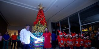 TAKE-OFF. Councilor Al Ryan Alejandre and Park Inn by Radisson Davao hotel manager Emelyn Mauhay-Rosales lead the lighting of the hotel's Christmas tree to formally open the Yuletide season on Thursday night. The abandoned children at The Love the Children Foundation are the chosen beneficiaries of the hotel's Christmas advocacy. LEAN DAVAL JR.