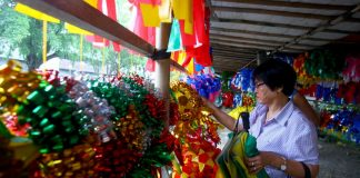 SEASON ICON. An elderly woman chooses from the wide array of Christmas lanterns on display at a makeshift store along Tionko Avenue in Davao City on Thursday. LEAN DAVAL JR.