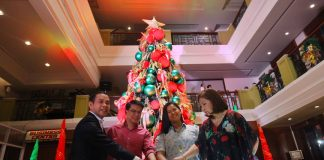 GRAND ILLUMINATION. Escandor matriach Violeta (rigthmost), granddaughter Irina Glenne (2nd from left), The Royal Mandaya Hotel general manager Benjie Banzon (leftmost) and Tourism 11 director Robbie Alabado lead the lighting of the hotel's Christmas tree to mark the start of Holiday season on Friday night. Part of the celebration is the unveiling of the hotel's newly modernized facilities. LEAN DAVAL JR.