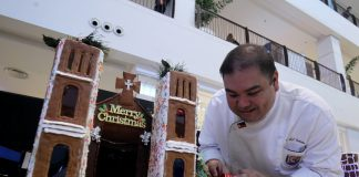 TOUGH CRITERIA. ASEAN master trainer Chef Rene John Custodio of IChef Davao examines one of the entries of Christmas inspired cake contest during the school's Global Skills 2017 Culinary Competition held at the activity center of Abreeza Mall on Thursday. LEAN DAVAL JR
