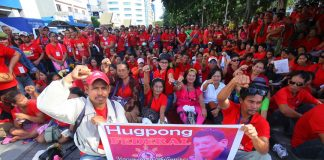 PUTTING MESSAGE ACROSS.Hundreds of President Duterte supporters flash their clenched fists during the 'Revolutionary Government Now' rally organized by Hugpong Federal at Freedom Park in Davao City on Thursday. LEAN DAVAL JR.