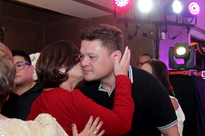 IN THE PUBLIC EYE. Former Davao City Vice Mayor Paolo Duterte is greeted by his mother, Elizabeth, upon his arrival during the golden wedding anniversary of Angel and Thelma Derla at The Royal Mandaya Hotel over the weekend. It's the first time that the former vice mayor attended a public gathering after President Duterte accepted his resignation on January 5. LEAN DAVAL JR.