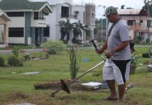 GREAT FATHER. A man is commissioned by a family to cut the grasses on their departed loved ones' grave at the Davao Memorial Park on Monday. The man proudly said his job helped him pay for his two children's college education. LEAN DAVAL JR .