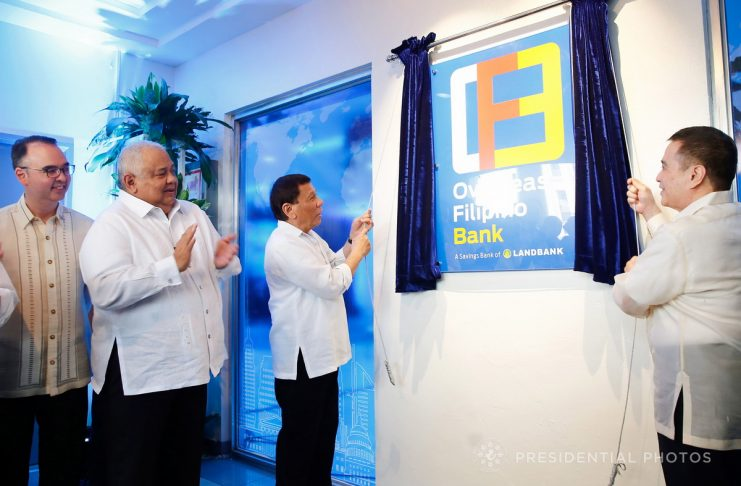 IN THE SERVICE OF OFWS. President Rodrigo Duterte leads the unveiling ceremony of the marker of Overseas Filipino Bank (OFBank) during its inauguration at the Postbank Center, Liwasang Bonifacio in Manila on Thursday. Also in the photo are Foreign Affairs Secretary Alan Peter Cayetano, Executive Secretary Salvador Medialdea and OFBank Chairman Alex Buenaventura. PRESIDENTIAL PHOTO