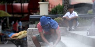 RIGHT FIT. A worker is covered with dust as he cuts a portion of a concrete stair of the newly refurbished Commemorative Monument of Peace and Unity along San Pedro Street in Davao City on Wednesday. LEAN DAVAL JR.