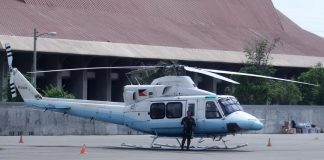 ON STAND-BY. A Philippine Air Force officer stands guard near the presidential chopper at the old terminal of Francisco Bangoy Airport in Sasa, Davao City. LEAN DAVAL JR.