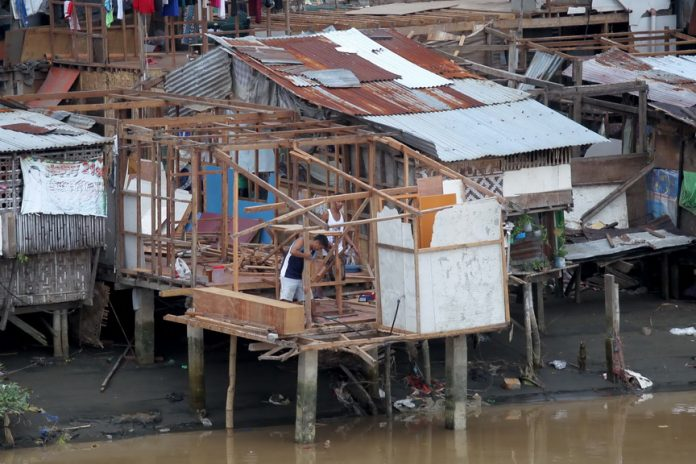 OF THEIR FREE WILL. Residents voluntarily dismantle their houses as the city government of Davao ordered the City Engineer's Office (CEO) to demolish all the houses erected along the riverbank of the Davao River as it is along the identified danger zone. LEAN DAVAL JR.