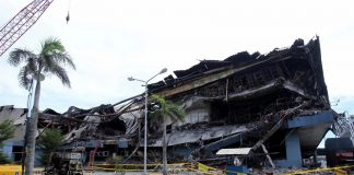 COMPLIANT OR NOT? The NCCC Mall Davao after it was razed by fire which claimed 38 lives. Authorities have suspended operations of the shopping mall and SSI citing failure to fully comply with fire safety requirements for five successive years. LEAN DAVAL JR.
