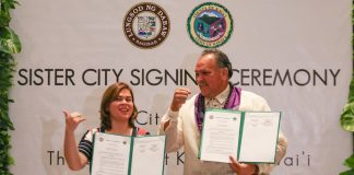 """Davao City Mayor Sara Duterte and Mayor Bernard P. Carvalho, Jr. of Kaua'i County of Hawaii show their signed sister city agreement on February 5, 2018 in Davao City. Carvalho said tourism and agriculture, particularly on cacao and coffee farming, can be areas that Davao and Kauai could work on together. Duterte, on the other hand, said both cities can """"mutually benefit"""" from each other's agriculture, tourism, culture and trade. MindaNews photo by MANMAN DEJETO"""