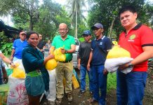 HELP FOR FLOOD VICTIMS. Distribution of relief goods and food packs to victims displaced by the December flashfloods in the hinterland areas of the Third Congressional District occupied the time and effort of Rep. Alberto T. Ungab and his allies among barangay leaders during the month of January, according to belated reports from Calinan. In this January 5, 2018 photo release, Rep. Ungab hands over a pack of food and relief items to a lady. With him are barangay captains Rogelio dela Cruz of Dalagdag, Cesario Darunday of Dacudao and Ramon Bargamento of Mintal. Photo by Clemme Kane