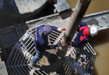 BUILT TO LAST. Workers lower the metal cylinder which will be used in the concreting works for the deep foundation of San Rafael bridge in Ma-a, Davao City on Wednesday. LEAN DAVAL JR