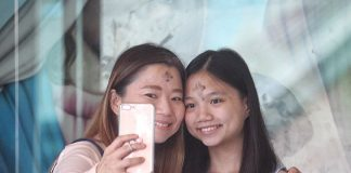 FOLLOWING TRADITION. A mother and her teenage daughter proudly take a selfie with crosses of black ashes on their foreheads after they attended an early morning Ash Wednesday mass at St. Joseph the Worker Parish in Sasa, Davao City. For Catholic faithful, Ash Wednesday is the first day of Lent and a reminder of God's enormous love for humankind. LEAN DAVAL JR