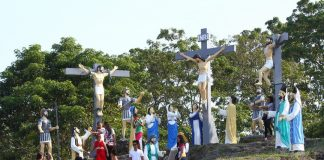 Church goers and devotees gather at St. Francis Xavier Parish's Calvary Hill in Barangay Tibungco, Davao City over the weekend to have their photos and selfies taken with the statues. Hundreds of Catholic faithful visit this pilgrimage site which became part of their traditional rituals every Holy Week. Lean Daval Jr