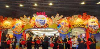 MILESTONE. Bakery Fair chair Bien Enrico Ah (center), Filipino-Chinese Bakery Association, Inc. president Peter Fung (6th from right), and Councilor Al Ryan Alejandre (5th from left) lead the cutting of ribbon to mark the opening of 2018 Bakery Fair-Davao at SMX Convention Center in Lanang on Thursday. LEAN DAVAL JR