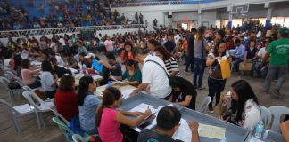 CLOSER TO HOME. Thousands of Dabawenyos troop to Almendras Gym on Wednesday for the pre-verification and submission of requirements for passport application and renewal through the passport on wheels on March 16 to 17. LEAN DAVAL JR