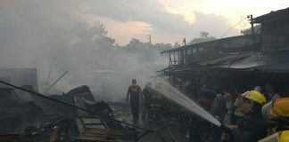 At least 31 structures were razed by fire in Purok Pag-asa, Bankerohan public market in Davao City on Monday afternoon, 02 April 2018. The fire reportedly started at around 4 pm and was placed under control at 5:15 pm. MINDANEWS PHOTO