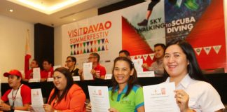 SMB WITH VDSF. San Miguel Brewery, Inc. communication officer Meggy Santos, together with Visit Davao Summer Festival (VDSF) executive committee members and representatives from the other partner companies, shows signed Memorandum of Agreement (MOA) during the official launch of VDSF at Seda Abreeza Hotel on Tuesday. LEAN DAVAL JR