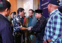 "PEACE ASSEMBLY. President Rodrigo Roa Duterte shakes the hand of Moro Islamic Liberation Front Chairman Al-Hajj Murad Ebrahim at the sidelines of the Peace Assembly for the Ratification of Republic Act No. 11054 or the Bangsamoro Organic Law (BOL), held at the Shariff Kabunsuan Cultural Complex in Cotabato City on Friday night. Also in the photo are Presidential Spokesperson and Chief Legal Counsel Salvador Panelo, Interior and Local Government Secretary Eduardo Año, Presidential Adviser on the Peace Process Carlito Galvez Jr., Philippine National Police Director General Oscar Albayalde, Defense Secretary Delfin Lorenzana, and Former Special Assistant to the President Christopher Lawrence ""Bong"" Go. PRESIDENTIAL PHOTO"