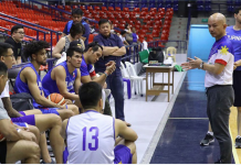 Gilas coach Yeng Guiao with the ten players who showed up for practice on Monday night.