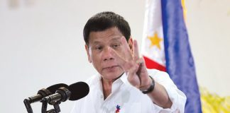 President Duterte gestures while delivering his arrival speech from Auckland, New Zealand and the Asia-Pacific Economic Cooperation (APEC) leaders' meeting in Lima, Peru at the Davao International Airport in Davao city on Wednesday night. Lean Daval J