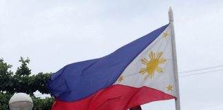 AUTHENTIC HERO. A Philippine flag waves prominently in front of the statue of Andres Bonifacio, considered as the father of the Philippine revolution, at his monument along the junction of C.M. Recto Avenue and Magallanes Street in Davao City yesterday. The whole nation will be commemorating the 153 birthday of Bonifacio today. LEAN DAVAL JR.