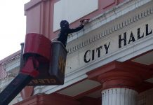 An electrician from the City General Office (GSO) installs Christmas lights at the façade of City Hall building few days before the opening ceremony of Pasko Fiesta 2016. LEAN DAVAL JR.
