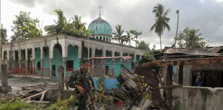 A soldiers walks past a bombed-out mosque in Butig town in Lanao del Sur on Thursday. Government troops retook Butig town a day earlier, after being occupied by the Maute group for days. But it took a day to clear the town of unexploded ordnance. MindaNews photo by Froilan Gallardo