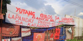 MARBAI members deliver their message along the highway in Madaum, Tagum City. Lapanday Foods Corporation denied involvement in the December 12 shooting incident in the banana plantation that injured seven farmworkers. MindaNews photo by Gregorio Bueno