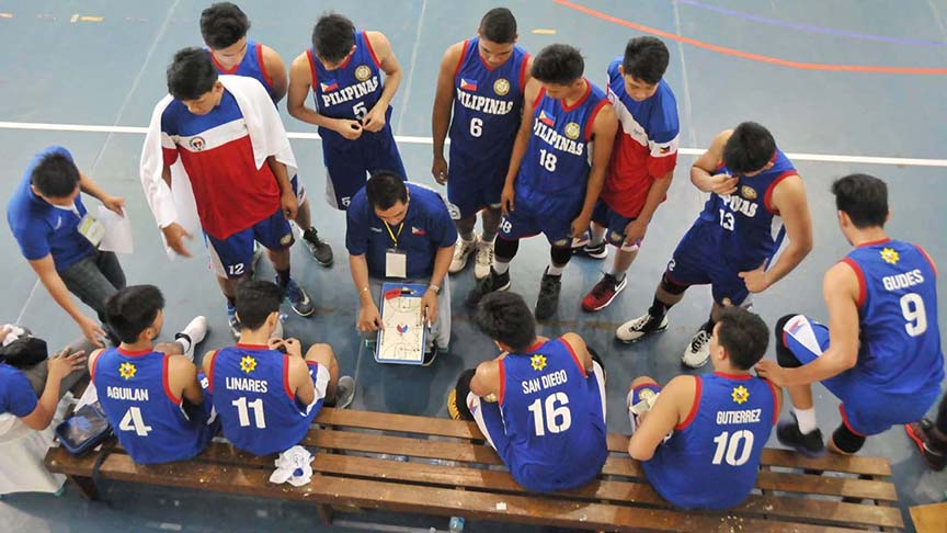 HUDDLE. Members of the men's basketball team of Philippines Minndanao huddle around coach Ice Gravador during a timeout. CIO
