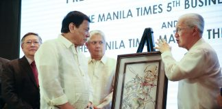 President Rodrigo Roa Duterte looks on as Manila Times Chairman Emeritus Dante Ang and President and CEO and Executive Editor Dante Francis Ang II unveils the caricature of the President who was awarded as the 'Manila Times Man of The Year' during the 5th Manila Times Business Forum at Marco Polo Hotel in Davao City on February 10, 2016. TOTO LOZANO/Presidential Photo