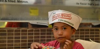 Junior Doughnut Master for a day. A boy from Providence Home of St. Joseph munches the glazed doughnut he has decorated during the fun doughnut tour at Krispy Kreme SM City Davao on March 16, 2017. JERMAINE L. DELA CRUZ