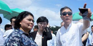 SITE VISIT. Vice Premier Wang Yang (right) of the People's Republic of China conducts a site inspection with National Economic and Development Authority (NEDA) 11 director Maria Lourdes Lim and other Chinese officials to the proposed Port and Coastal Development project at Sta. Ana Port in Davao City yesterday. LEAN DAVAL JR.