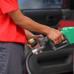 GOOD NEWS.A pump attendant refills a customer's vehicle at a gasoline station along E. Quirino Avenue in Davao City yesterday. Oil firms announced another round of rollbacks in pump prices of petroleum products as a result of lower cost of crude in world markets. LEAN DAVAL JR