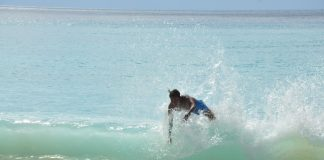 THROUGH THE WAVES. A skimboarder sails through rough waves at Dahican Surfer Resort in Mati City during the annual Summer Frolic festivities. Skimboarding is a popular watter sport in the eastern coastal city. ARMANDO FENEQUITO JR.