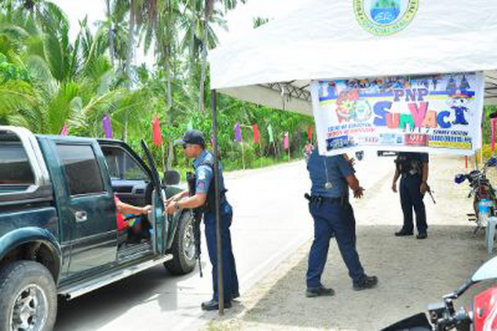 ENSURING SAFETY. Police officers of the Davao Oriental Police Provincial Office check a vehicle bound to Dahican Beach in Mati City to ensure the safety and security of all tourists who will be joining the Visit Davao Fun Sale (VDFS) events in Dahican. DOPPO-PCR/ARMANDO B. FENEQUITO JR