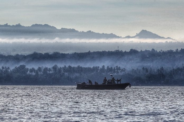 SECURED. Security forces belonging to the Philippine Navy conduct a routine sea patrol between Davao City and Island Garden City of Samal (IGaCoS) on Sunday. The Philippine Navy is among the agencies that provided security as the Department of Tourism (DOT) 11, local government unit of IGaCoS and private sector held tourism-related summer activities in the island. LEAN DAVAL JR.