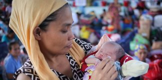 Anisa Bongcarawan, 39, holds her infant daughter Asmira at an evacuation center for Marawi City residents in Brgy Maria Cristina, Iligan City on Saturday, June 24, 2017. Asmira, her 8th child, was born on Independence Day, June 12, 2017. MindaNews photo by Manman Dejeto