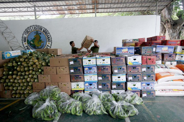 MARAWI-BOUND. Soldiers arrange boxes of bananas donated by a banana growers organization ready to be delivered to the victims of the recent conflict in Marawi City at the Eastern Mindanao Command (EastMinCom) in Panacan, Davao City on Friday afternoon. LEAN DAVAL JR.