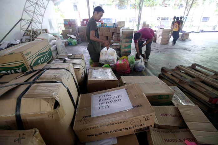 ASSISTANCE. Boxes of milk and canned goods donated by residents of Davao City are being gathered by personnel of 10th Infantry Division of the Philippine Army for the victims of the recent conflict in Marawi City at the Eastern Mindanao Command (EastMinCom) in Panacan, Davao City on Friday afternoon. LEAN DAVAL JR.