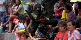 NOTHING LEFT TO CHANCE. A Task Force Davao personnel inspects a cardboard box owned by bystander at the Centennial Park along San Pedro Street in Davao City on Tuesday. LEAN DAVAL JR.