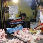 JUST IN TIME. A trader prepares special chicken cuts at a stall inside Agdao Public Market in Davao City on Saturday. LEAN DAVAL JR.
