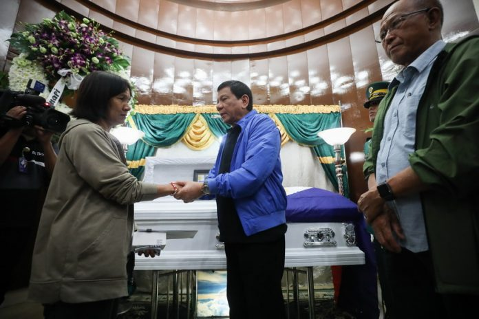 FALLEN HERO. President Duterte condoles with the bereaved mother of late PFC Sherwin Marco Canapi as he visits the wake of the slain soldier at the mortuary in Fort Bonifacio, Taguig City on Tuesday night. Canapi along with 11th Scout Ranger Company Commander Capt. Rommel Sandoval were killed while trying to rescue their wounded comrade during a clearing operation in Marawi City on September 10. ROBINSON NIÑAL JR./PRESIDENTIAL PHOTO