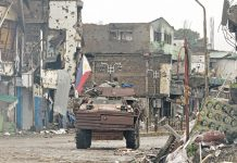 """A Marine V150 armored personnel carrier patrols Quezon Avenue in Bangolo, Marawi City on Tuesday, 17 October, 2017. President Duterte declared on the same day that the city has been """"liberated from terrorist influence"""". MindaNews photo by Froilan Gallardo"""